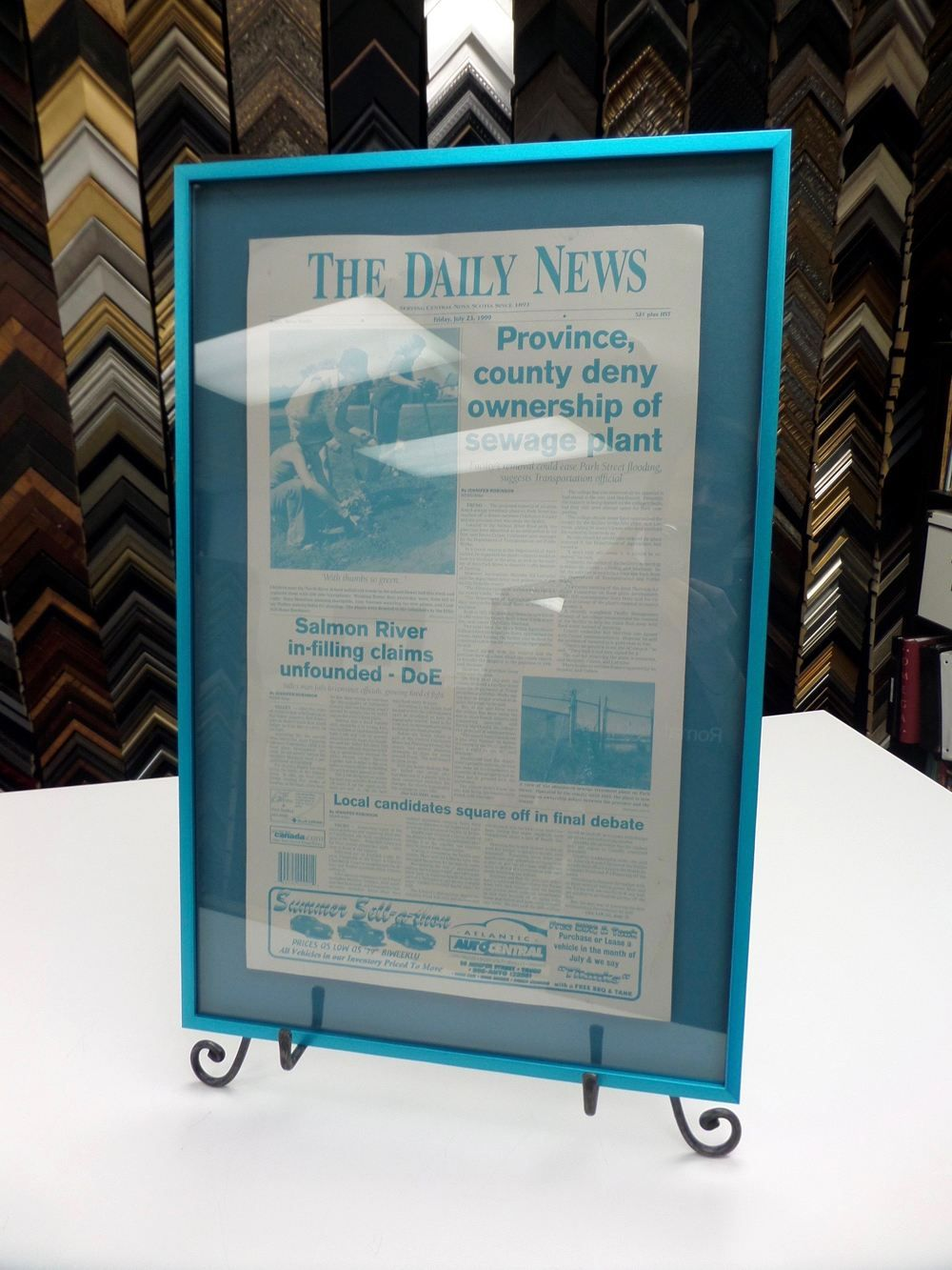 a newspaper page custom framed